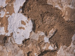 texture of an old mud wall with sprinkled whitewash