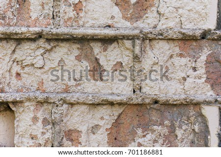 Texture of an old ruined brick wall.  #701186881