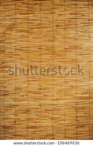 texture of an orange mats made ??of bamboo and rope