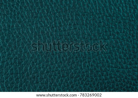 Texture of artificial leather. Dark greenish-blue background. #783269002