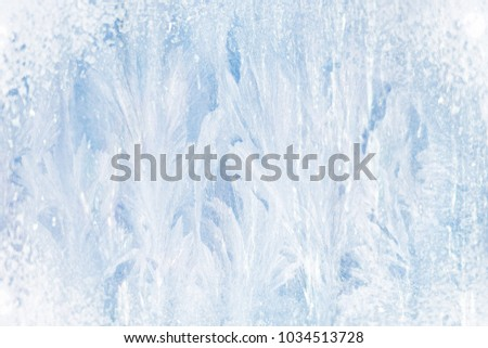 Texture of beautiful ice patterns on blue glass #1034513728