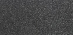 Texture of black foam rubber and background, close-up. Panorama.