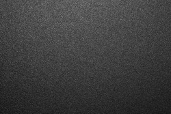 Texture of black matte plastic.Black and white matte background.The background is black rough plastic.