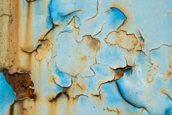 Texture of blue and yellow metal wall with rust and peeling paint, can be used as overlay or texture
