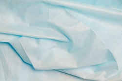 Texture of blue crumpled non-woven fabric for sewing disposable protective medical clothing