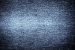 Texture of blue jeans textile close up. Blue color of denim texture with copy space for advertise or vintage background.