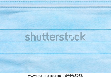 texture of blue medical surgical mask for background