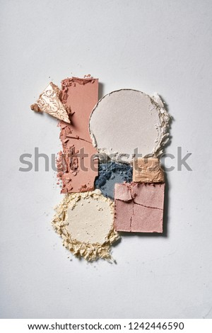 Texture of broken colorful eyeshadow, blush or powder. Macro texture of broken and colorful powder, background