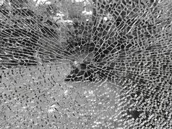 Texture of broken & shattered glass of a door window