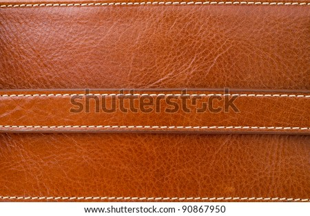 Texture of brown leather and Stitched with white thread