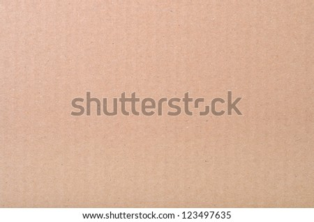 Texture of brown paper. Ecological paper with waste paper.