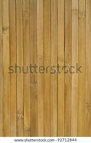 Texture of brown vertical stripes arranged in bamboo veneer in the background