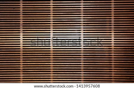 Texture of brown wooden lath wall background on horizontal line with horizontal highlight in the middle for presentation.