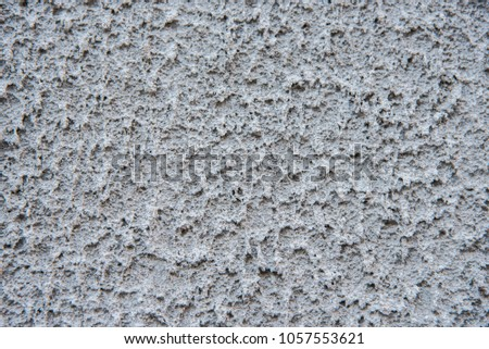 texture of cement plaster on the wall of the house #1057553621