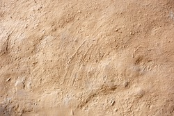 Texture of clay house structure. Wall of soil house. Mud background and vintage tone, soft picture