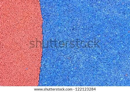 Texture of color rubber floor on playground. ( Ethylene Propylene Diene Monomeror EPDM)