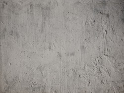 Texture of concrete wall for background. Rough unpainted concrete wall.