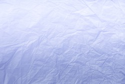 Texture of crumpled navy blue wrapping paper with white gradient, closeup. Light lilac old vintage background. Material backdrop