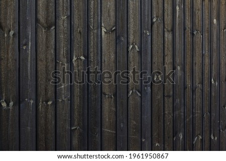 Texture of dark barn wall made from homemade rough sawn timber. Knotty boards treated with varnish and pine tar. Stock photo ©