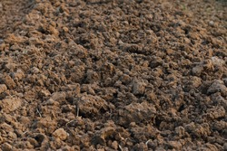Texture of dark soil before growing plant background