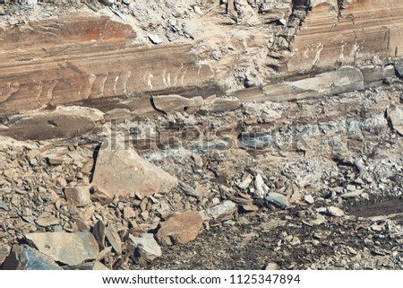 Texture of different layers of soil. Layers of soil. Excavated ditch for the commencement of construction of a commercial building, a residential building #1125347894