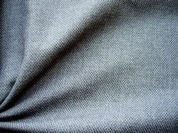 Texture of fabric. Gray woolen fabric. Gray background.