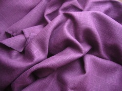Texture of fabric. Linen cloth, cotton cloth. Purple fabric. Purple flax. Purple cotton.