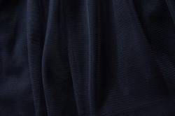 Texture of fabric Tulle. Black fabric tulle background
