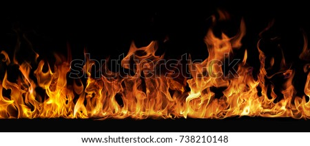 Texture of fire on a black background. #738210148