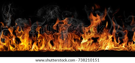 Photo of  Texture of fire on a black background.