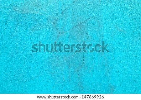 Texture of fracture on blue concrete wall