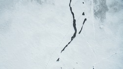 Texture of Frozen Lake Covered with snow Aerial Vertical Top-Down View