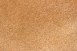 Texture of genuine leather close-up, beyge brown color print. For your background, backdrop, with copy space