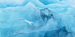 Texture of glacier ice in close-up detail. Realistic ice pattern structure