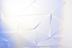 Texture of glass fragments. Gradient of white and blue colors. Mosaic of triangular glass fragments.