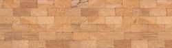 Texture of golden sandstone bricks