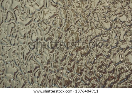 Texture of Gray frosted glass. Background with free space for text or design. Rough glistening rough surface