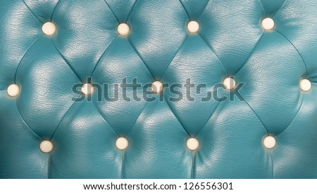 Texture of green blue leather of sofa background