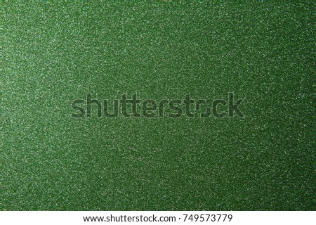 texture of green glitter paper background for design Christmas or New Year's cards #749573779