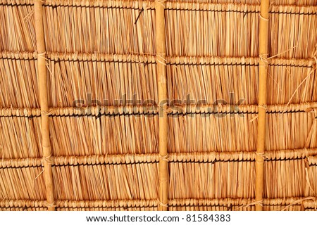Texture of hay stack roof and bamboo in Thailand. closeup Useful as background for design-works.