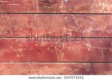 Texture of horizontal old wooden red fence or boards