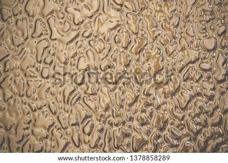 Texture of light beige frosted glass. Background with free space for text or design. Rough glistening surface