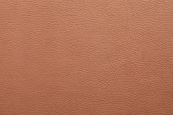 Texture of light brown leather as background, closeup
