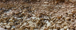 Texture of limestone background. The image of stones' pile for use as a background. Many limestone rocks.