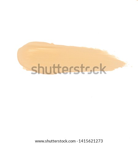 Texture of liquid foundation.Liquid foundation smudges isolated on white background. #1415621273