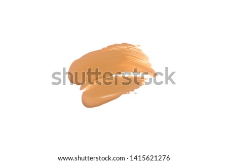 Texture of liquid foundation.Liquid foundation smudges isolated on white background. #1415621276
