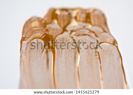 Texture of liquid foundation.Liquid foundation smudges isolated on white background. #1415621279