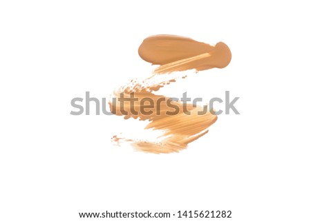 Texture of liquid foundation.Liquid foundation smudges isolated on white background. #1415621282