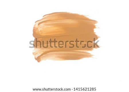 Texture of liquid foundation.Liquid foundation smudges isolated on white background. #1415621285