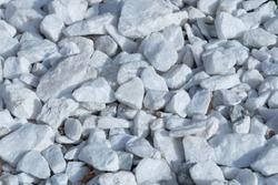 Texture of many white shiny stones.